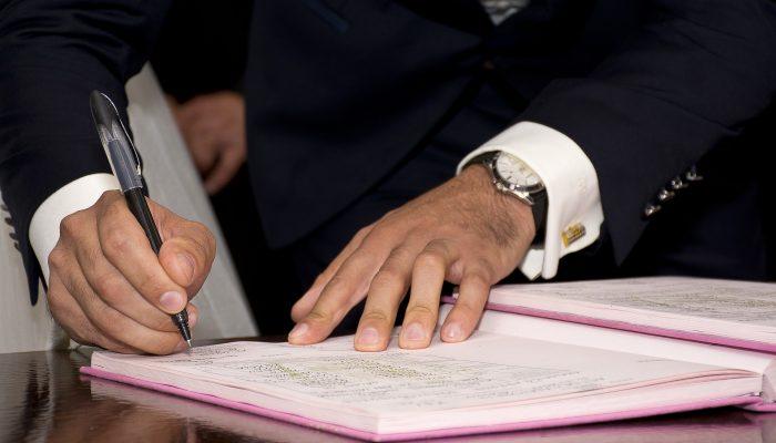 Man Signing Prenuptial Agreement